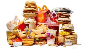 Sugary, high caloric, gluten rich, acid forming, inflammation causing foods. Do Not feed to animals!